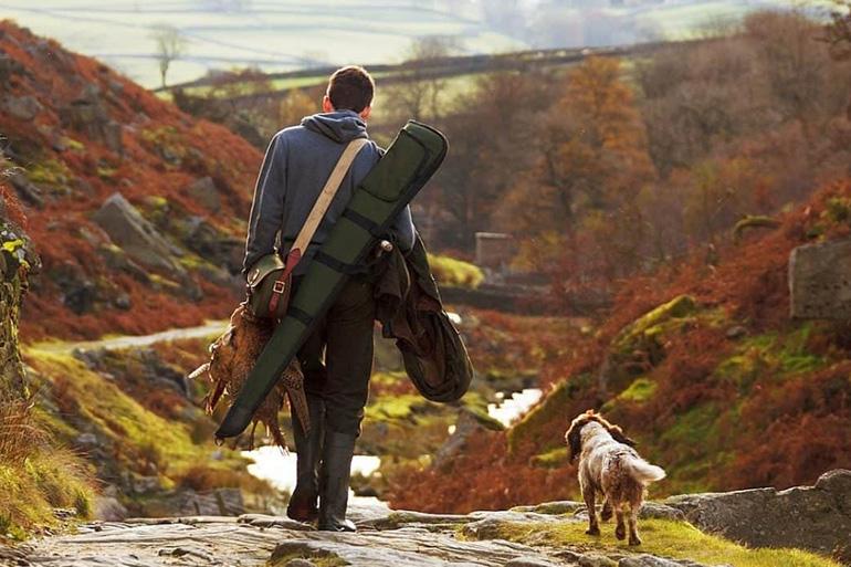 Собака с охотником